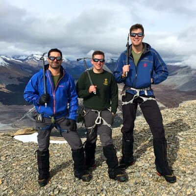 picture of a knee arthritis patient mountain climbing with 2 friends after successful surgery and rehabilitation